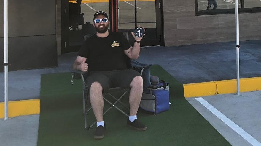 Man camps outside Carl's Jr to win free burgers for a year