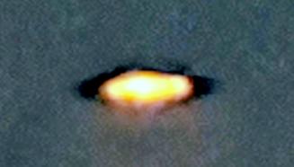 football shaped UFO Sighting