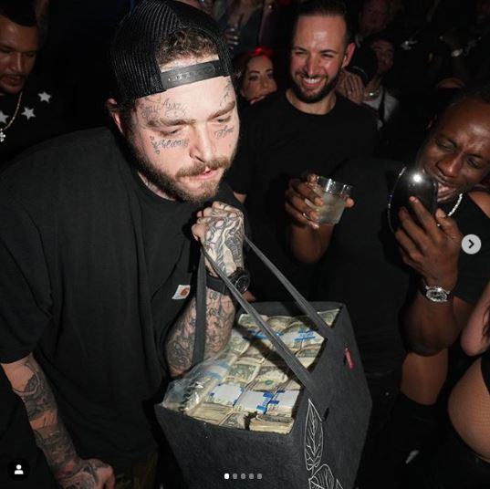 Post Malone Makes It Rain at Miami Club