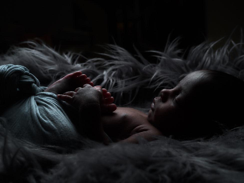 newborn baby , black and white photo, black furr