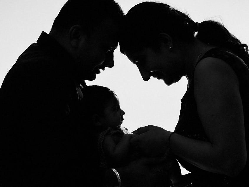 Family with newborn at Happy Kids Photo Studio