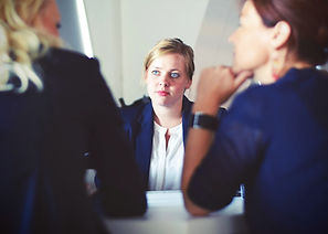 Individuals at a conference table seeking legal advice.