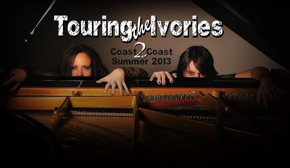 Scott and Michele playfully peek over the piano in anticipation of their 2013 coast to coast U.S. tour