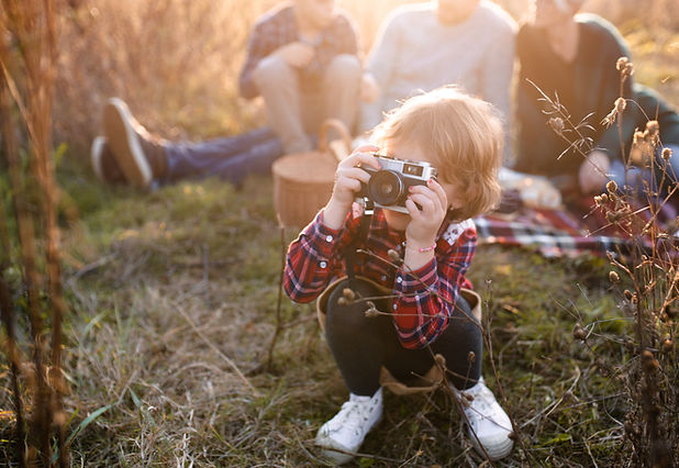 small-girl-with-family-on-picnic-in-autu