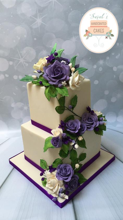 Purple and cream roses wedding cake