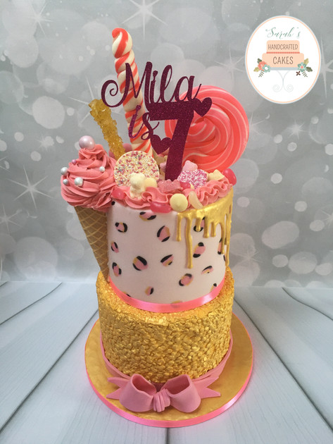 Pink, gold  and sweets chocolate drip birthday cake