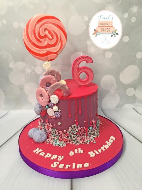 Pink and purple chocolate drip birthday cake