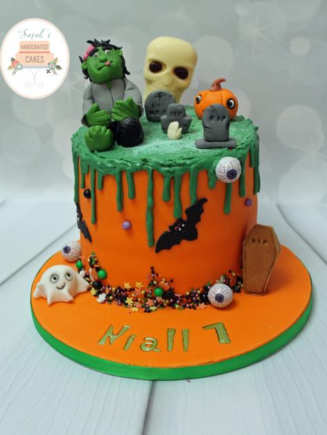Spooky themed drip birthday cake