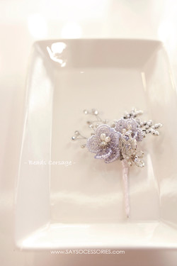 From groom, delicate beads corsage