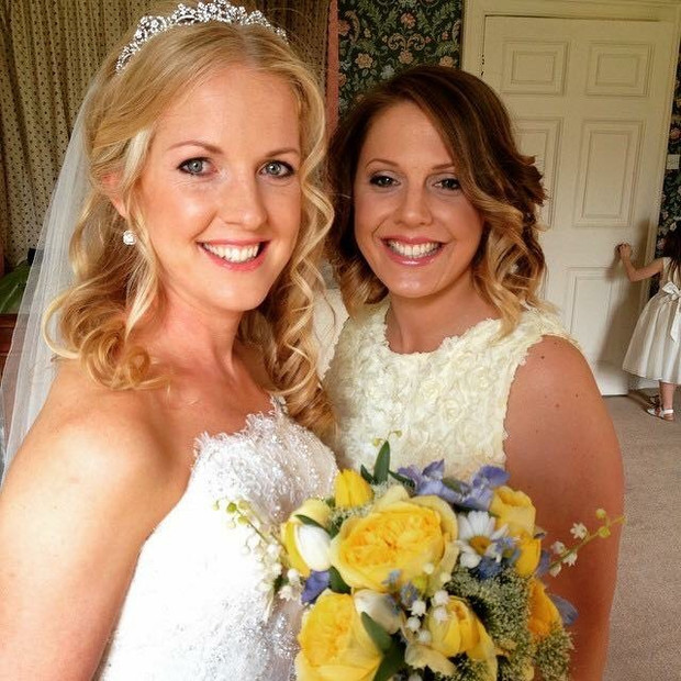 Blonde curly bride with maid of honour