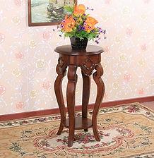 Graceful legged ornamental stand
