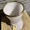 Thumbnail: Flinke lichtroze vaas met bronzen ring