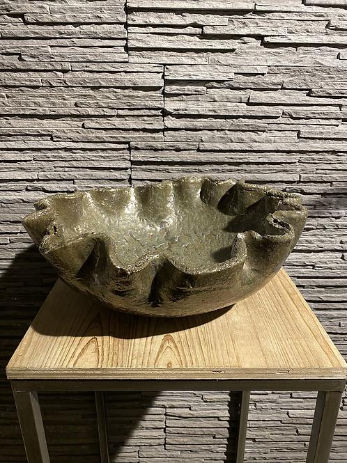 Gegolfde schaal van pottenbakker Prosman