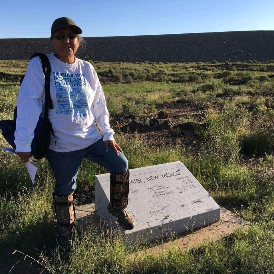 Bernadette stands in beautiful desert land next to monument for the reclamation project.