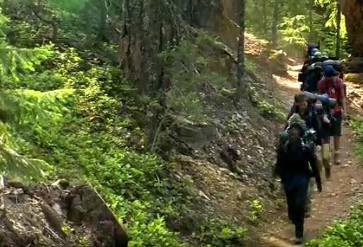 Boys Outdoor Leadership Training group hiking with full packs