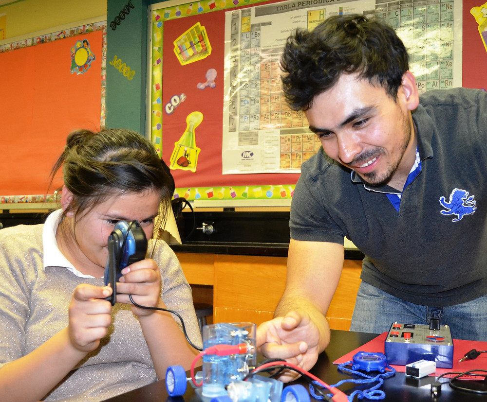 A MANOS student learns about fuel cells hands-on