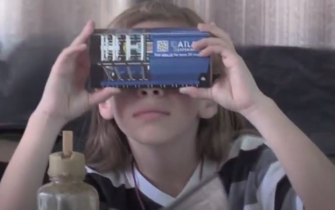 Student looking through virtual reality glasses