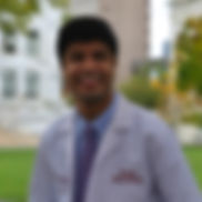 Azfar_White Coat_Headshot_edited.jpg