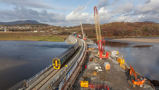 What difference has improving a road and rail bridge in North Wales made?