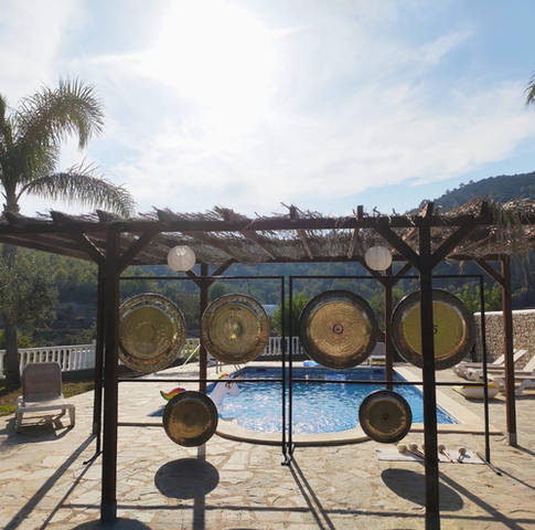 gong bath therapy on pool