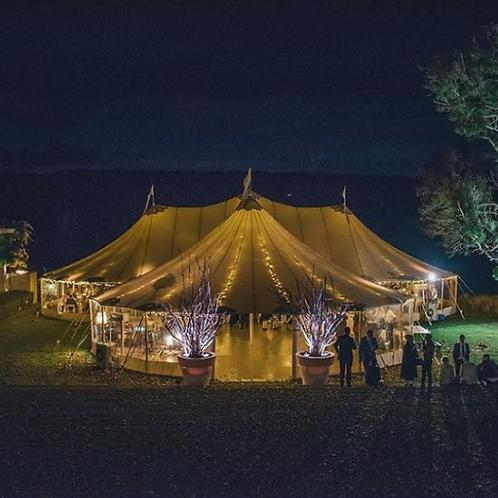 Triple peaked oblong tent.