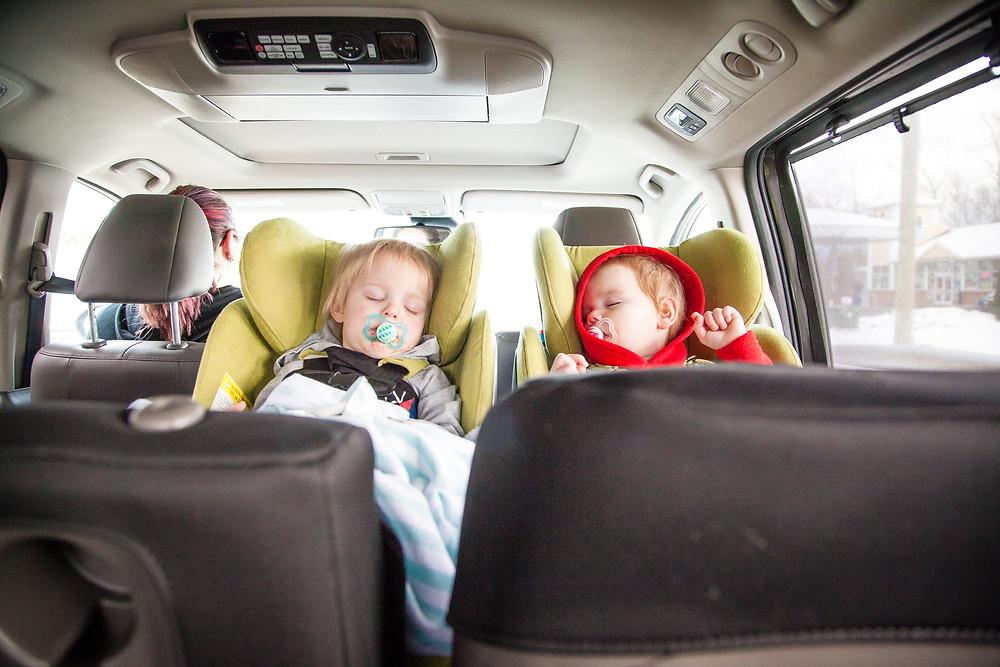 Children sleeping in a car.