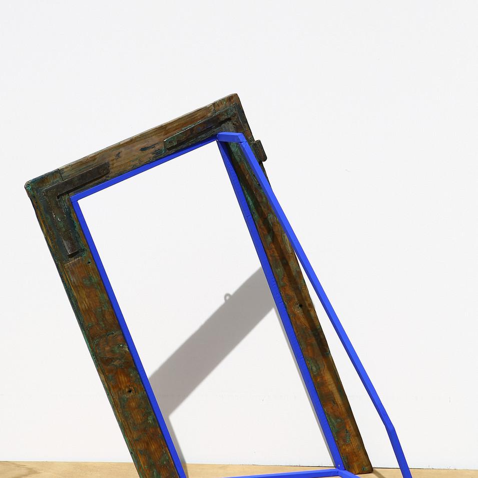 'Internal Design' Found window frame standing with blue painted wooden sticks
