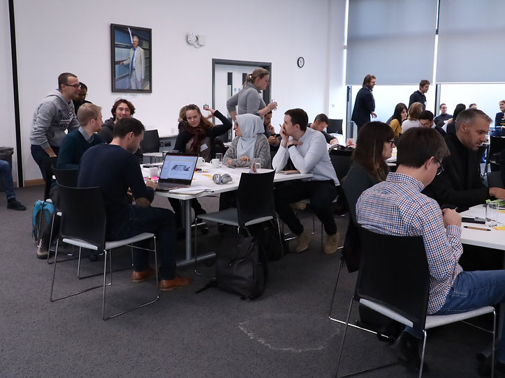 Photograph of men and women working on a group project at a Postdocs to Innovators (p2i) workshop