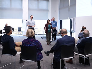 Photograph of a group presenting their business plan to a panel of experts at a Postdocs to Innovators (p2i) Enterprise Fair