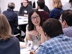 Photograph of a woman and a man discussing their project during a Postdocs to Innovators (p2i) workshop
