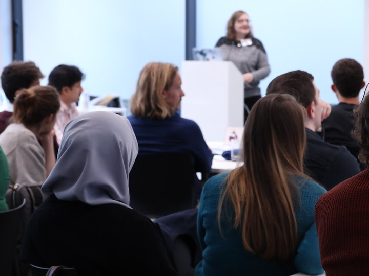 Photograph of men and women watching a presentation during a Postdocs to Innovators (p2i) workshop