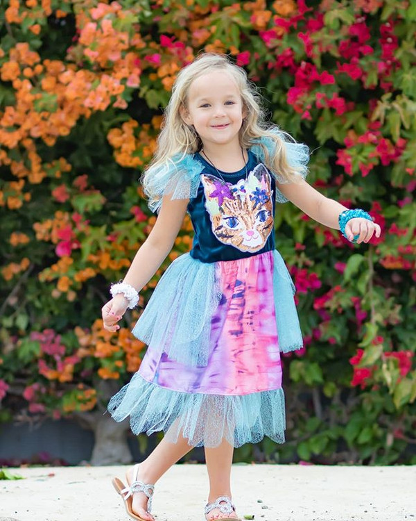 She spins and twirls, sings, and dances