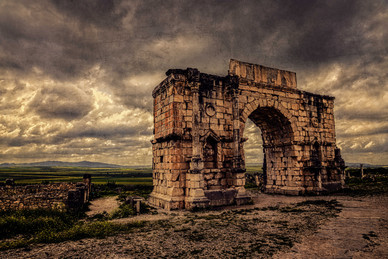 Triumphal Arch to the Ancient Roman City of Volubilis - Volubilis, Morocco
