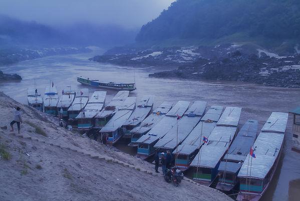 Boats before dawn tied up along the sandbank of Pak Bang, Laos