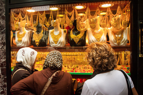 """Contemplating in Making a New Investment in the """"Bank of Mama"""" - Grand Bazaar, Istanbul, Turkey"""