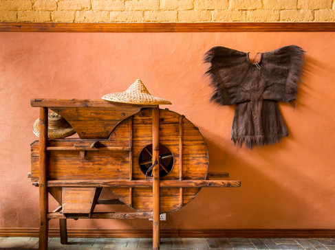 Still Life with Rain Coat, Peasant Hat and Rice Processor - Jiuxian, Guangxi, China
