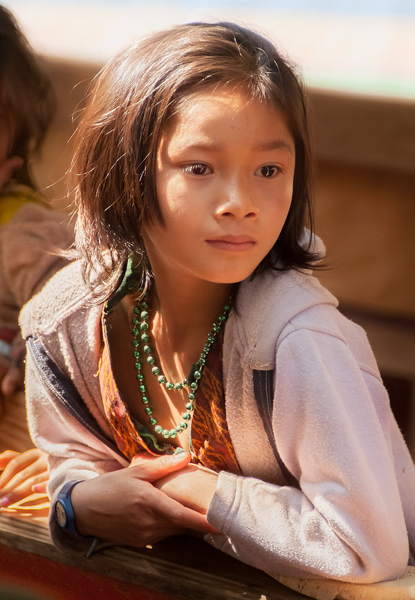 Portrait of a young Laotian girl on the Mekong River.