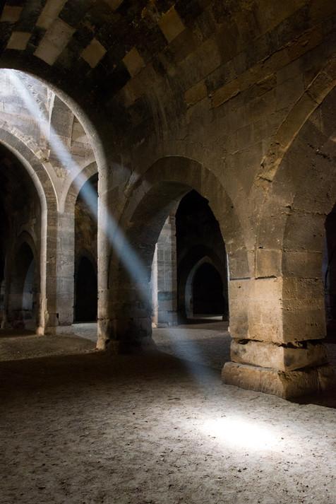 A Shaft of Light Illuminates the Interior of an Ancient Turkish Caravanseri or Han - Konya, Turkey
