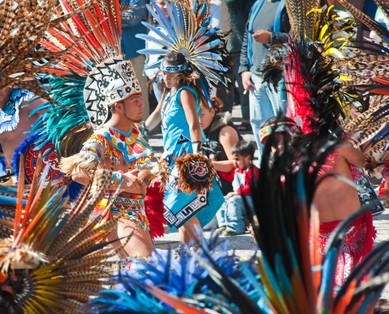 Concheros Dancing in the Streets - Photo of feather and costumned concheros dancing in the streets of San Miguel de Allende, Mexico