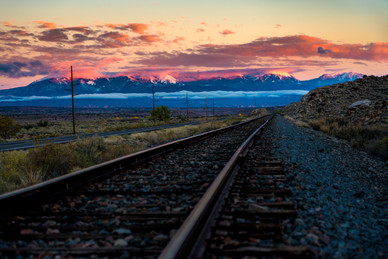 Tracks and Monti la Salles at Sunset - Moab, Utah