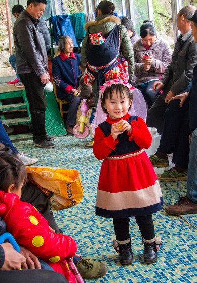 The Apple of Their Eyes; On a Ferry Crossing the Li River - Guangxi, China