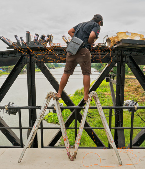 Where Is OSHA When You Need Them? - Setting Up Fireworks on River Kwai Bridge