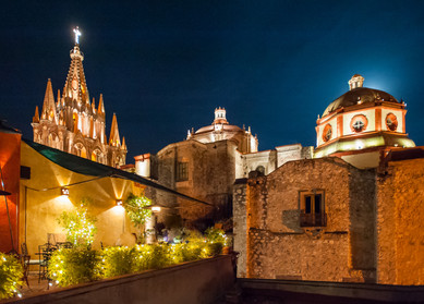 Night and the Parroquia - Photo of feather and costumned concheros dancing in the streets of San Miguel de Allende, Mexico
