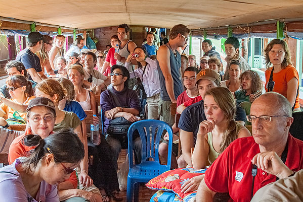 Anxious passengers await disembarkation as the boat is filled way beyond capacity.