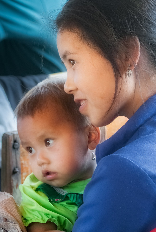 A mother and child after boarding our boat somewhere along the Mekong River.