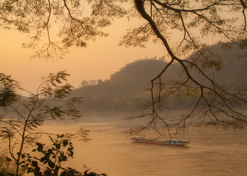 Several evenings during our stay we ate dinner at one several outdoor restaurants perched above the Mekong River, watching boats sail by as the sun set over Luang Prabang, Laos