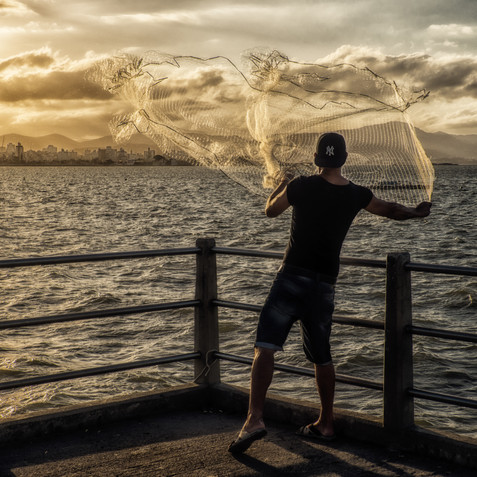 Casting His Net in the Waters Off the Island of Florianapolis - Santa Catarina, Brazil