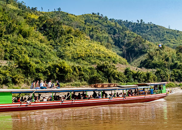Our sister ship sailing alongside us through peaceful section of the Mekong River.