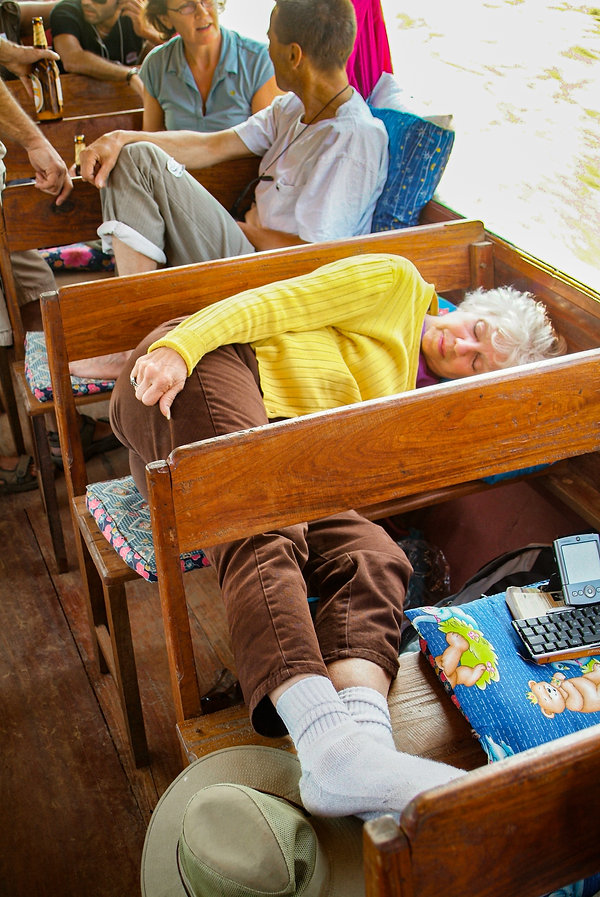 Yolanda napping uncomfortably on the cramped wooden benches of our boat.