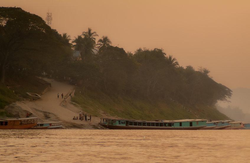 Arriving in Luang Prabang, Laos as a smoky dusk descends.